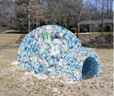 Wondering what to do with all those plastic bottles? Get a little inspiration from Bucky Fuller and go geodesic, or dream of colder places, and make an igloo.  Kids would love it!