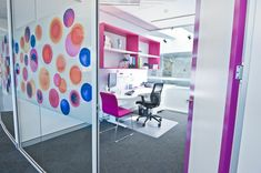 Throughout the space inOne used a number of different colourful graphics on glass walls and white walls to represent the company's branding. Their strategic positioning makes the space feel as if it has come to life and is complemented by the colourful seating options.