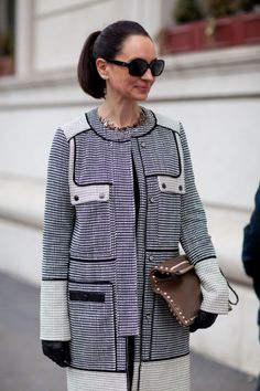 This Proenza Schouler coat and Valentino clutch are a cool combination.