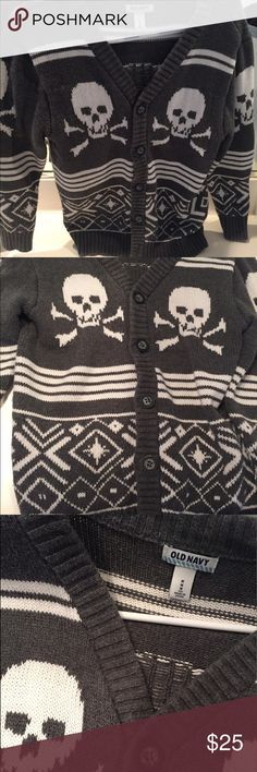 Old Navy Skull sweater Old Navy grey cardigan sweater. nice thick fabric. Hip cardigan. Only worn a couple times in great conditions. No stains or tears. Son just grew out. Size 7-10 Shirts & Tops Sweaters