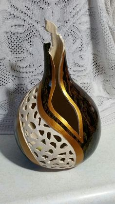 Carved and painted gourd.