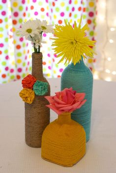 Rustic & pretty, wrapped wine bottle idea - wedding centerpieces