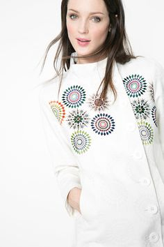 Check out the cute mandala detail on the back of this button up coat!