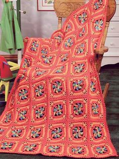 Child's Pinwheel Squares Crochet Afghan Pattern  The bright and cheery colors of this crochet afghan pattern make it perfect for a kid's room. Afghan size: 39 x 54 inches Skill level: Beginner  Designed by Roberta Maier  free pdf from free-crochet.com