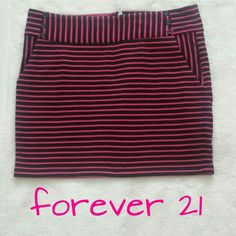 """Striped Skirt Striped bodycon skirt in fuschia and black. Back zipper closure. Side pockets. 83% polyester 17% cotton. Length 14.5"""" Waist 15.5"""" Excellent condition! Forever 21 Skirts"""