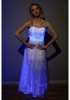 PRE-ORDER: Custom Made Item Takes 1-4 Weeks Glowing fiber optic gown dress with ultra bright rainbow color changing LED's. Amazing new fiber optic fabric lights-up & comes with lots of color setting options including white, blue, green, red, pink, and rainbow fade. Includes a remote so you can change the colors discreetly.  - Change your color setting by remote! <br> - rechargeable battery and includes charging cable too. <br> <br> Perfect for wedding, prom, danc...
