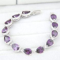 Witgoud vergulde armband met paarse druppelvormige zirkonia's