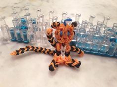 tiger with a tail, Aubie.  Rainbow Loom.  tiger adapted from: http://www.youtube.com/watch?v=lpkKn6Glp-0