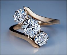 A Vintage Bypass Diamond Engagement Ring circa 1915 The rose gold ring features three sparkling antique cushion cut diamonds: x x mm, app Diamond Jewelry, Jewelry Rings, Jewelry Accessories, Fine Jewelry, Jewelry Design, Gold Jewelry, Jewellery Box, Jewelry Shop, Beaded Jewelry