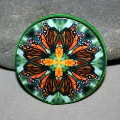 Monarch Butterfly Sacred Geometry Mandala Kaleidoscope glass bead magnet titled Timeless Treasure <br /> <br />Butterfly geometric mandala kaleidoscope glass magnet. Magnet is 50mm (just under 2 inches) and has a powerful magnet for secure placement on your fridge or magnetic surface. I have attached my kaleidoscope photo and applied a protective acrylic finish. <br ...