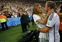 Winning: Gotze hugs his girlfriend Ann-Kathrin Brommel after his historic victory