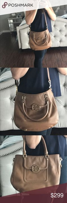 Tory Burch Amanda Hobo Bag - Great condition! Beautiful tan Amanda Hobo Bag with shoulder strap from Tory Burch. Excellent condition, have only used a few times. Large interior can fit keys, wallet, phone, mini iPad, book and more. Very clean outside and inside, a small mark on bottom front of Bag as seen in the photo. 💎 Back of Bag has a bit of staining from running against my jeans but nothing a simple swipe of a baby wipe won't clean! ✨ Price is negotiable 💕 Tory Burch Bags Hobos