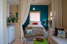 Use a curtain as a room divider. It's a great way to divide up a small space without making it feel cramped.