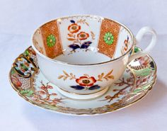 Beautiful tea cup and saucer.  An interesting mis-matched Tea Duo with Imari themes.