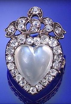 MOONSTONE AND DIAMOND BROOCH, CIRCA 1890.