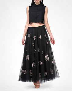 This Kavita Bhartia piece is young, delicate and festive. A black button-down textured crop top with a delicate flouncy full black net skirt with sequins.