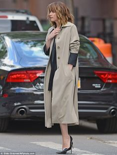 Giving herself a boost: The statuesque 26-year-old also wore black pumps with spindly stil...