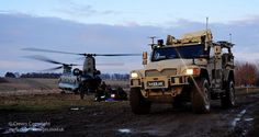 A Husky vehicle makes it's way past a Chinook helicopter and a contingent of Royal Marines, during an exercise on Salisbury Plain. Salisbury Plain, Chinook Helicopters, British Armed Forces, A Husky, Royal Marines, Submarines, Car Videos, Armored Vehicles, British Army