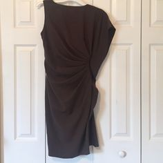 Dark Brown dress with one flowy sleeve I go this from a boutique here in Jacksonville. It's a more business professional look. 37 inches long Dresses