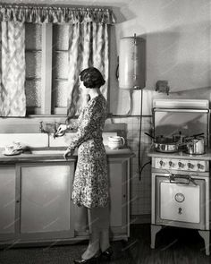"""Modern kitchen in New Zealand circa """"Model at sink in kitchen equipped with Atlas electric stove and Zip water heater."""" Studio of Gordon Burt, Wellington. Vintage Pictures, Old Pictures, Old Photos, Vintage Images, Old Kitchen, Vintage Kitchen, Kitchen Decor, Kitchen Interior, 1930s Kitchen"""