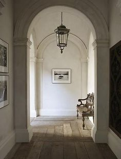 Light fixture with bench in hallway.