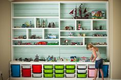 Lego storage ideas. Loose pieces, instruction sheets, and finished projects.  Complete with a place to play!