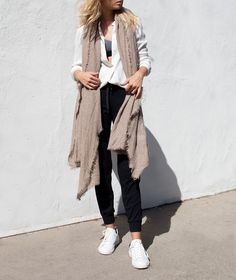 Raquel Allegra white henley frayed hem, Jane Carr oatmeal cashmere scarf, NO KA'OI relaxed pants, Isabel Marant white sneakers
