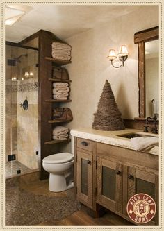 The towel storage is awesome and the stone floor spills out from the shower.