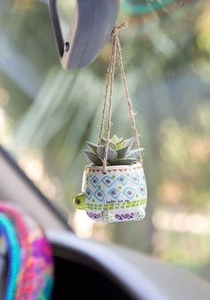 Does anyone need a mini critter succulent hanging from their rearview mirror? It's the perfect little addition to any car, desk or windowsill… any space that could use a little brightening up! Succulent and container combination Hanging Succulents, Faux Succulents, Cute Car Accessories, Car Hanging Accessories, Vehicle Accessories, Pots, Cute Cars, Natural Life, Rear View Mirror