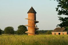 Charles Back brought goats to his Fairview Cheese and Wine Farm at Fairview in South Africa, and built them a tower so they could climb like they were used to.
