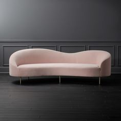 """Shop Curvo Pink Velvet Sofa. """"One of my favorites, the Curvo velvet sofa, is a nod to Italian midcentury designs by way of its fluid lines,"""" explains Gwyneth Paltrow. In signature goop style, the undeniably elegant form doesn't sacrifice on comfort."""