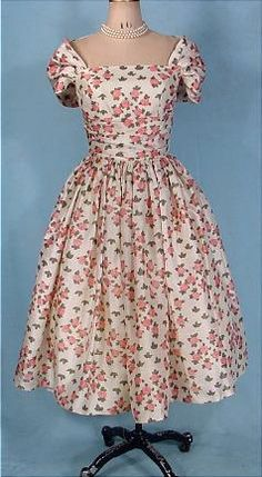 Vintage short party dress in ivory silk with pink roses & off the shoulder cap sleeves from Cahill (circa 1950).