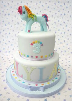 #Tiered #Birthday #Cake with #Cute #Rainbow #Pony topper! We love and had to share! Great #CakeDecorating!