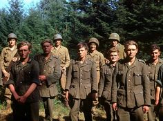 American troops stand guard behind German soldiers captured near the town of Le Gast during the Normandy invasion, June 1944.