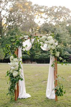 Davies Manor Plantation Wedding. Love this arch. Who's got some hydrangea bushes I can cut? haha