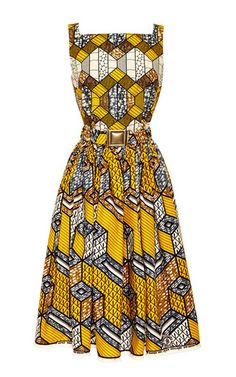 This printed wax cotton **Lena Hoschek** dress is sleeveless and features a straight, square neckline, fitted bodice with detachable self-belt, and a gathered knee-length skirt with in-seam side pockets.