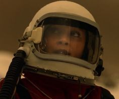 """Raven rayes (Lyndsey Morgan) pilots the capsule up to the space station in the """"100"""" episode """"Praimfaya"""" (2017)"""