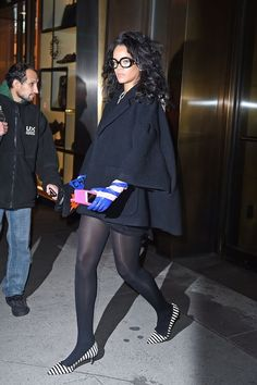 Fashion Icon Rihanna was seen leaving Da Silvano Restaurant in Christian Dior Fall 2014 Blue and Pink Striped Leather Gloves, Chanel Fall 2014 Furry Clutch, and Manolo Blahnik Striped Pumps. Rihanna Dress, Rihanna Outfits, Rihanna Riri, Rihanna Style, Fashion Outfits, Womens Fashion, Rihanna Fashion, Rihanna Red Carpet, Winter