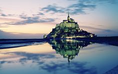 Reflections of Mont Saint-Michel, reminds me of the Emerald City.