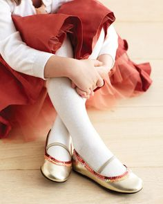 Sequined Shoes    Put a spring in your flower girl's step by outlining her ballet flats with two rows of sequins. Choose a metallic shoe, like the pair shown here, and you'll be her BFF for life.