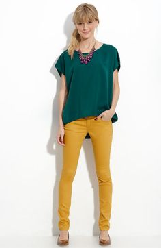 Mustard skinny jeans + teal blouse + purple statement necklace