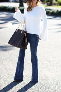 Love the 70s vibe of these flared jeans styled with a bell sleeve blouse!