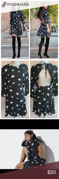 NWT Star Dress long sleeve black and white ruffles NWT dress with white stars on black. Open back with ruffle trim and bottom hem of dress ruffled.   Original price $58.  Offers welcome. Please ask any and all questions. Thanks! Dresses Backless