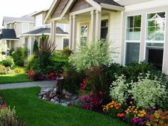 outdoor home decorating with flowers, window boxes and flower beds