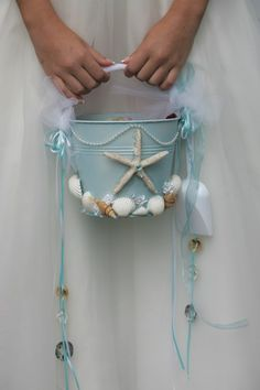 for sam Cuuute idea for bri: Beach Wedding Flower Girl Starfish Beach Pail by artseero on Etsy. But Definitely looks easy enough for a DIY! If we have a beach wedding Beach Wedding Flowers, Beach Wedding Reception, Beach Wedding Decorations, Beach Wedding Favors, Nautical Wedding, Destination Wedding, Wedding Planning, Wedding Colors, Wedding Souvenir