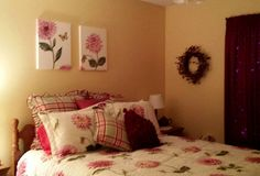 floral canvases painted to match the floral bedding.