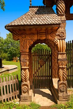 Traditional carved wooden Maramures folk art church gate at Breb, Nr Sighlet, Maramures, Transylvania