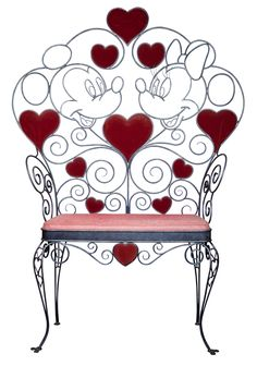 This oversized metal chair, once used as a photo opportunity at Magic Kingdom Park at the Walt Disney World Resort, features Mickey Mouse and Minnie Mouse, part of D23 Expo 2013 Silent Auction.