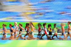 Athletes compete in the Women's 5000m Round 1 during the athletics competition at the Rio 2016 Olympic Games at the Olympic Stadium in Rio de Janeiro on August 16, 2016.   / AFP / FRANCK FIFE