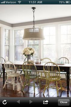 Spray painted dining chairs for pops of color. Love the whole look.